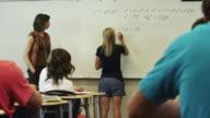 MS DS Math class, student writing on whiteboard / Spanish Fork City, Utah, USA
