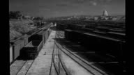 Matte special effects rail yard matte painting of Washington DC applied to establishing shot of rail yard / transition seen with clapboard Matte...