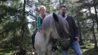 Mature Adult Couple horseback riding
