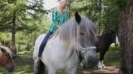 Mature Adult female horseback riding