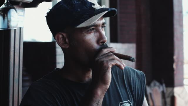 Mature adult male smoking cigar in Havana, Cuba