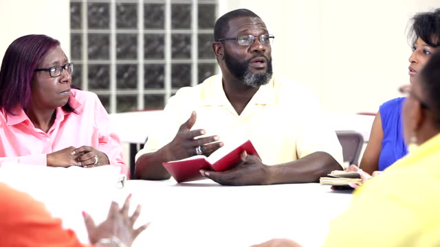 Mature black man and women in bible study group