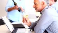 Mature business man drinking white wine
