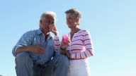 Mature couple blowing bubbles