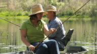 MS Mature couple fishing on lake / Madison, Florida, USA