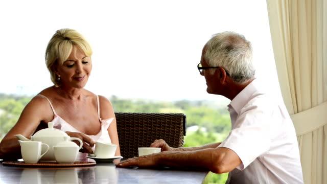 Mature couple has tea