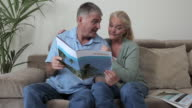 Mature couple looking at a holiday brochure