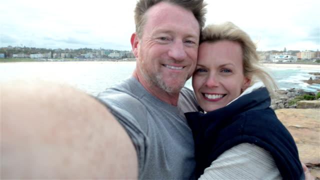 Mature couple making a selfie video