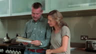 Mature couple opening and reading letter