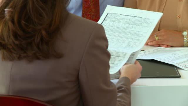 CU, PAN, Mature couple signing financial documents, Richmond, Virginia, USA