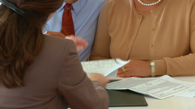 CU, PAN, Mature couple signing financial documents, Richmond, Virginia, USA
