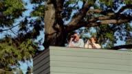 MS, LA, mature couple using binoculars, standing on observation platform, USA, Pennsylvania, Solebury