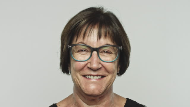Mature excited woman smiling at camera