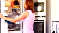Mature female looking for food in refrigerator