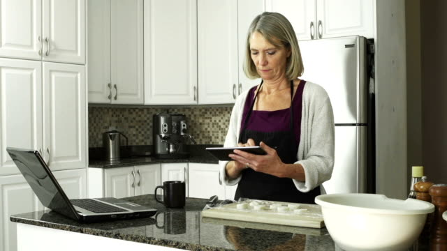 Mature lady in the kitchen