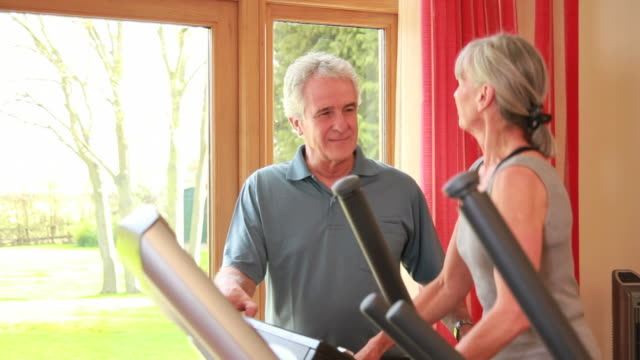 Mature male and female exercising