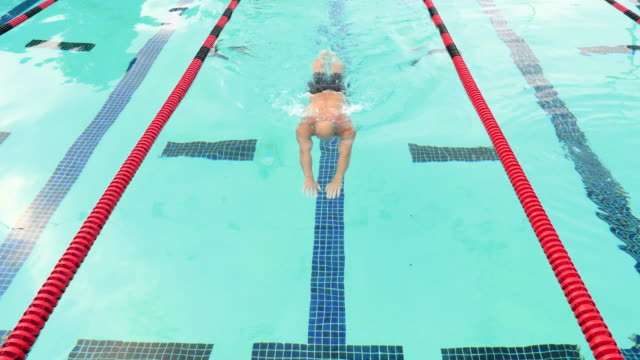 MS HA Mature male athlete swimming breaststroke during morning workout