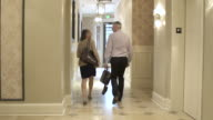 Mature man and a mature woman leaving a hotel