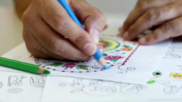 Mature Man Coloring a Coloring Sketch