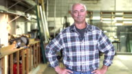 Mature man in plate glass warehouse