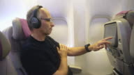 MS Mature man using In-flight entertainment