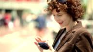 Mature urban woman texting outdoors
