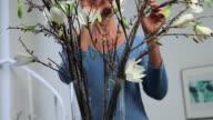Mature woman arranging flowers