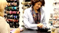 Mature  woman buying a necklace