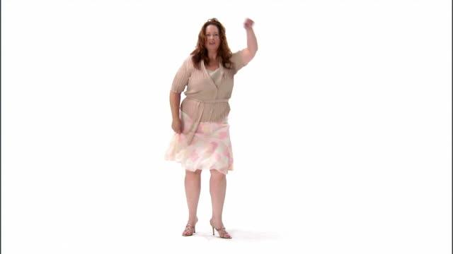 WS, mature woman dancing in studio