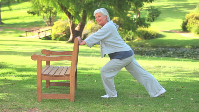 Mature woman doing her stretches / Cape Town, Western Cape, South Africa