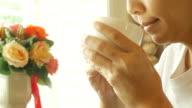 Mature woman drink hot tea