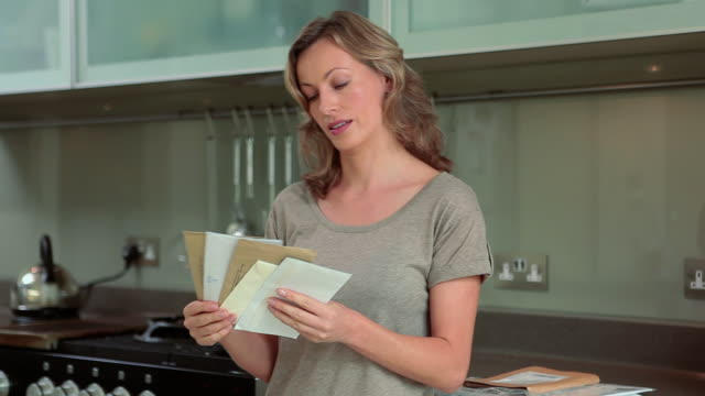 Mature woman opening and reading letter