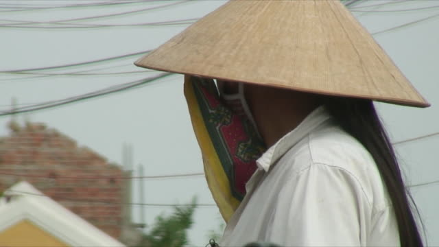 CU Mature woman wearing conical hat, Hoi An, Vietnam