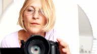 Mature woman with camera