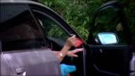 Mavis Maynard driving into parking spot and getting out of car Mavis Maynard interview SOT INT Parking enforcement officer along to clamp car wheel...