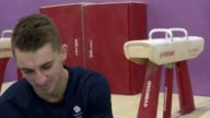 London INT Max Whitlock interview SOT Various of Whitlock doing floor gymnastics and somersault spin in air