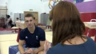 London INT Max Whitlock set up shots with reporter / interview SOT Various of Max Whitlock on pommel horse