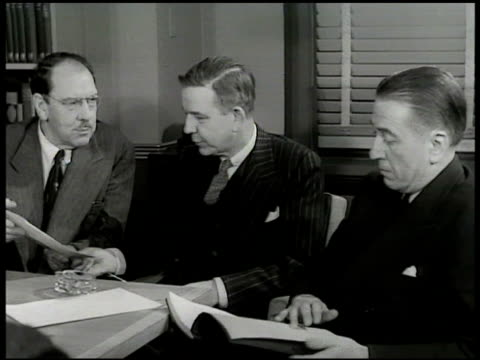 Maxwell Anderson attorney John F Wharton producer Leland Hayward sitting at table Leland Hayward asking Max Anderson if he thinks 'Anne of a Thousand...