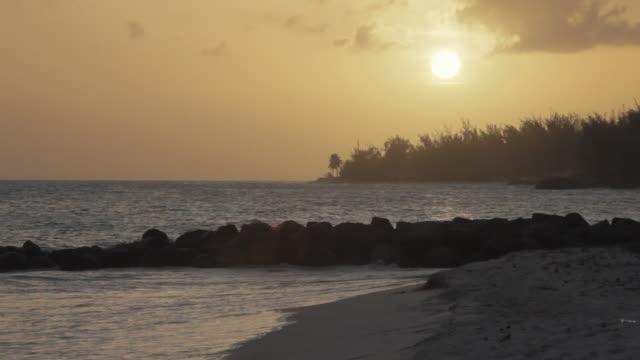 WS Maxwell beach at sunset / Oistins, Christ Church, Barbados