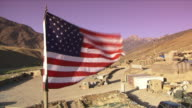 May 1 2009 WS American military base with US flag blowing in wind / Najil Afghanistan