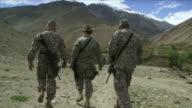 May 1 2009 MS POV American soldiers walking / Panjshir Valley Afghanistan