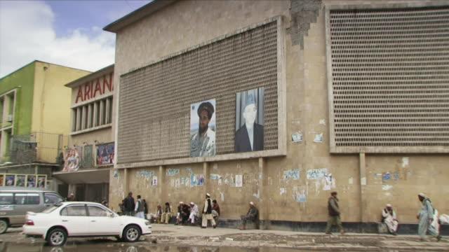 May 1 2009 WS ZI CU Building with photographs of Hamid Karzai and General Massoud / Kabul Afghanistan