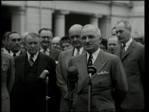 May 17 1949 MS President Harry S Truman talking at microphones to press about the medal he just presented to Lucius Clay / Washington DC United States