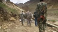 May 18 2009 WS POV Afghan and US soldiers walking / Panjshir Valley Afghanistan / AUDIO
