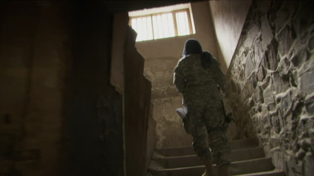 May 18 2009 WS POV American female soldier going up stairs / Panjshir Valley Afghanistan / AUDIO
