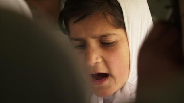 May 18 2009 CU SELECTIVE FOCUS Schoolgirl reading aloud / Panjshir Valley Afghanistan / AUDIO
