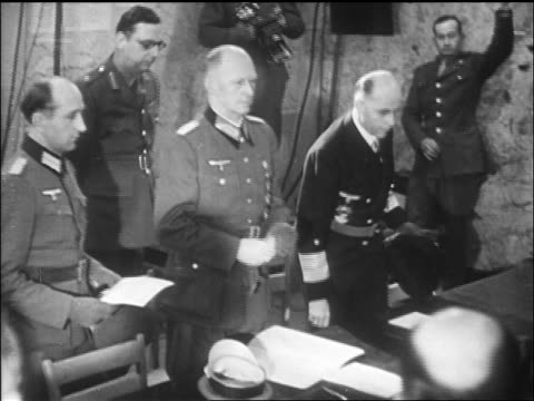 B/W May 1945 Nazi General Jodl other Nazis sit before signing surrender / newsreel