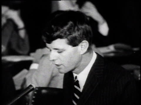 May 1965 MONTAGE Robert Kennedy testifying on gun control before Congressional committee / Washington DC United States