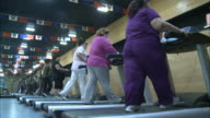 May 2 2010 MONTAGE Overweight women walking and running on treadmills / China