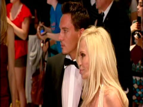 May 2009 MS FOCUS Actor Jonathan Rhys Meyers with designer Donatella Versace posing for photographers at the White House Correspondents' Dinner/...